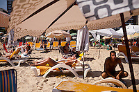 Beach-goers around Posto 9, and area known for beautiful people, young hipsters, and alternatives, in Ipanema, Rio de Janeiro, Brazil, on Saturday, Feb. 2, 2013.