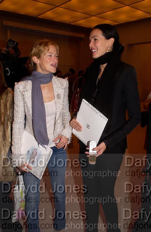 Caroline Murphy and L'Wren Scott, Chanel couture fashion show, Paris, 20 January 2004. © Copyright Photograph by Dafydd Jones 66 Stockwell Park Rd. London SW9 0DA Tel 020 7733 0108 www.dafjones.com