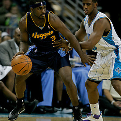 Dec 18, 2009; New Orleans, LA, USA;  Denver Nuggets guard Ty Lawson (3) is guarded by New Orleans Hornets guard Chris Paul (3) during the first half at the New Orleans Arena. Mandatory Credit: Derick E. Hingle-US PRESSWIRE
