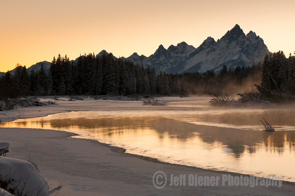 The Snake River steams at sunset in Grand Teton National Park, Jackson Hole, Wyoming.