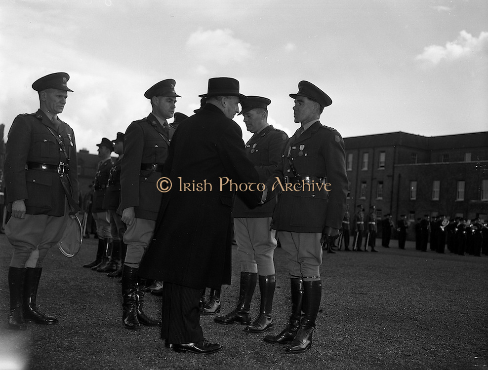 11/04/1960<br /> 04/11/1960<br /> 11 April 1960<br /> The United Nations Medal was presented to 47 Officers of the Irish Army who served in U.N.O. forces in 1959/60,by the Taoiseach Sean Lemass at a ceremony at Collin's Barracks, Dublin. <br /> Picture shows: The Taoiseach congratulating Captain William J. O'Flynn of the Southern Command.