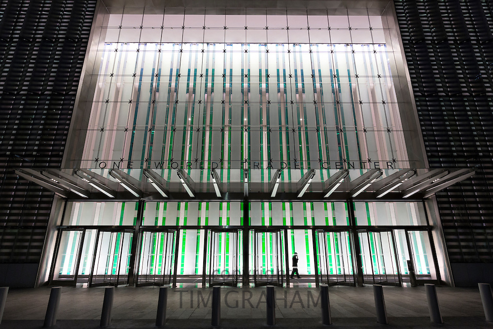 Entrance of the new One World Trade Center with electric lights on in Downtown New York, USA
