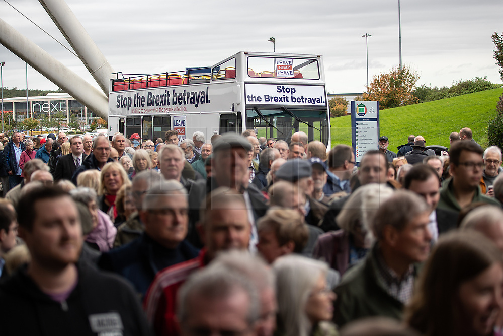 """© Licensed to London News Pictures . 22/09/2018. Bolton, UK. People queue by the Stop the Brexit betrayal Believe in Britain bus outside the stadium . Pro Brexit campaign group Leave Means Leave host a """" Save Brexit """" and """" Chuck Chequers """" rally at the University of Bolton Stadium , attended by leave-supporting politicians from a cross section of parties , including Conservative David Davis , former UKIP leader Nigel Farage and Labour's Kate Hoey . Photo credit: Joel Goodman/LNP"""