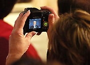 A member of the audience at Browns Ferry Nuclear Plant photographs President Bush during his speech on power Thursday.  photo by Gary Cosby Jr. 6/21/07