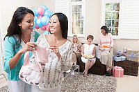 Woman showing gift at baby shower