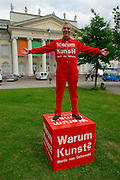 "Martin von Osowski's performance ""Warum Kunst?"" (Why Art?) in front of the Fridericianum."