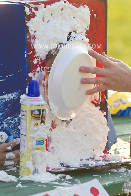 Middletown, New York - A boy is hit in the face with a whipped cream pie during the Camp Funshine Carnival Night on Aug. 16, 2012. The night celebrated the Middletown YMCA summer camp, which ended the next day.
