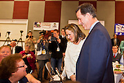 21 FEBRUARY 2012 - PHOENIX, AZ:  Former Senator and Republican Presidential candidate RICK SANTORUM accompanied by his wife, KAREN SANTORUM, greets supporters at the Maricopa County Lincoln Day lunch in Phoenix. Santorum was in Phoenix Tuesday for an Arizona Republican party leadership luncheon ahead of the state's Republican Presidential Primary election and a CNN Republican Presidential Primary debate, which is Wednesday, Feb. 22.     PHOTO BY JACK KURTZ