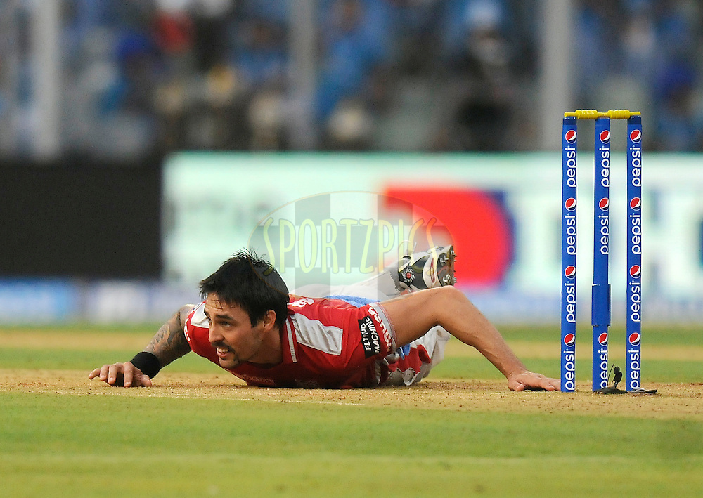 Mitchell Johnson of the Kings X1 Punjab lookd on after missing a run out chance during match 22 of the Pepsi Indian Premier League Season 2014 between the Mumbai Indians and the Kings XI Punjab held at the Wankhede Cricket Stadium, Mumbai, India on the 3rd May  2014<br /> <br /> Photo by Pal Pillai / IPL / SPORTZPICS<br /> <br /> <br /> <br /> Image use subject to terms and conditions which can be found here:  http://sportzpics.photoshelter.com/gallery/Pepsi-IPL-Image-terms-and-conditions/G00004VW1IVJ.gB0/C0000TScjhBM6ikg