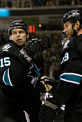 April 8, 2010; San Jose, CA, USA; San Jose Sharks center Joe Thornton (19) celebrates with left wing Dany Heatley (15) after scoring a goal against the Vancouver Canucks during the second period at HP Pavilion.  San Jose defeated Vancouver 4-2. Mandatory Credit: Jason O. Watson / US PRESSWIRE