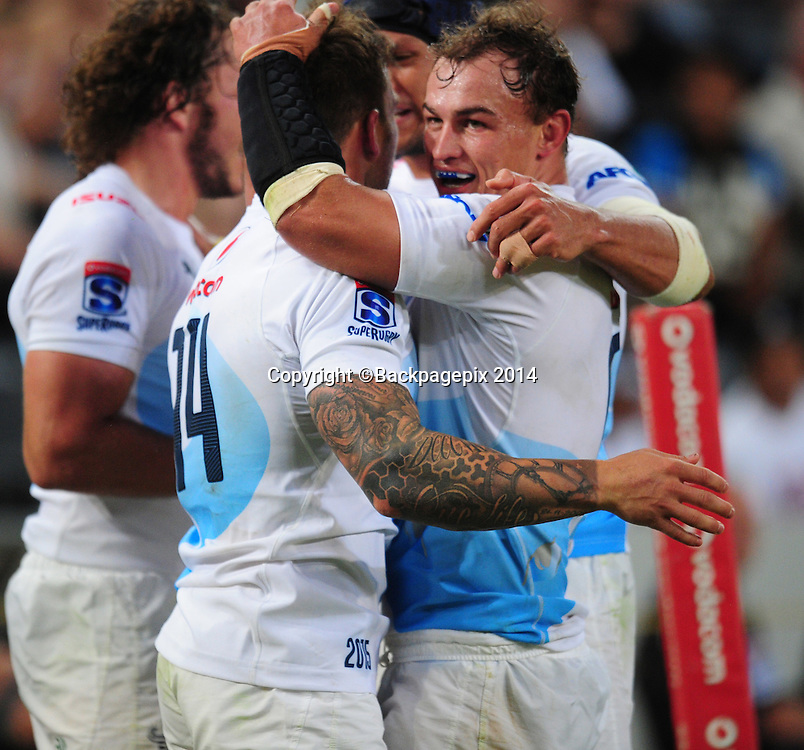 Bulls celebrate a try during the 2015 Super Rugby match between Sharks and Bulls at the Kings Park Stadium in Durban on the 18th  of April 2015<br /> <br /> &copy;Sabelo Mngoma/BackpagePix