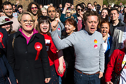 © Licensed to London News Pictures. 03/05/2018. London, UK. Stand up comedian and Labour NEC member EDDIE IZZARD (left) and Journalist and Labour activist OWEN JONES (right) cheer outside Pimlico Tube Station as part of the 'Unseat Westminster Tory Council'. The gathering was arranged to round up volunteers to speak to Westminster residents who said they would vote for labour. Photo credit : Tom Nicholson/LNP