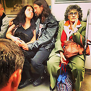 Couple and elderly woman travelling back home by tube, Budapest 2015.