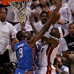Jun 21, 2012; Miami, FL, USA; Miami Heat small forward LeBron James (6) shoots over Oklahoma City Thunder power forward Serge Ibaka (9) during the third quarter in game five in the 2012 NBA Finals at the American Airlines Arena. Mandatory Credit: Derick E. Hingle-US PRESSWIRE