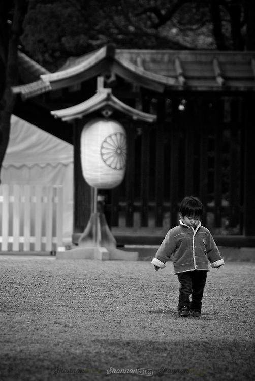 A Japanese young boy walks alone in Meiji Jingu Gyoen (Meiji Shrine Park), Harajuku, Tokyo, Japan. February 2008<br /> <br /> Editorial or Personal Use Only.<br /> No model release.