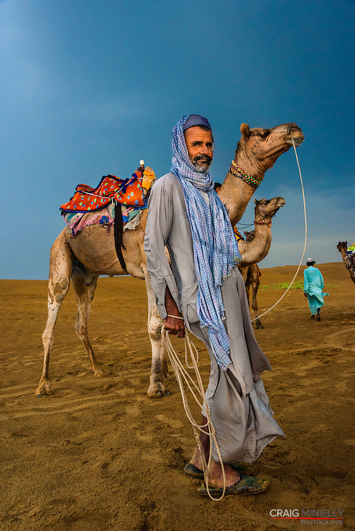 Camel guide in Great Thar Desert, Jaisalmer, India<br /> <br /> Nikon D750 34mm  ISO 4000  f9  1/200s