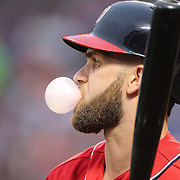NEW YORK, NEW YORK - July 09: Bryce Harper #34 of the Washington Nationals blows a bubble while waiting to bat during the Washington Nationals Vs New York Mets regular season MLB game at Citi Field on July 09, 2016 in New York City. (Photo by Tim Clayton/Corbis via Getty Images)