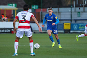 AFC Wimbledon midfielder Max Sanders (23)taking on Doncaster Rovers defender Reece James (3) during the EFL Sky Bet League 1 match between AFC Wimbledon and Doncaster Rovers at the Cherry Red Records Stadium, Kingston, England on 14 December 2019.