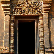 Prasat Mueang Tam Khmer Temple in Buriram, Thailand. This Khmer site has a square layout. Its main structures are 5 brick pagodas built on the same foundation and enclosed by two walls. The 4 doorways are perpendicular to each other and built of sandstone with beautiful designs. The inner wall is made of sandstone and is one long, narrow continuous corridor, called Rabiang Khot. The outer wall is made of laterite. Lintels adorn doorways and the main pagoda, recounting Hindu tales. Another highlight of the site is the 4 large pools between the walls. The edges of the pools have serpent designs with the head at the pool corner. .View is March 2007.