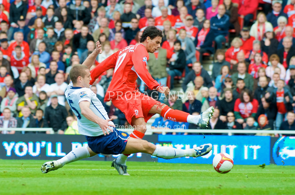 MIDDLESBROUGH, ENGLAND - Saturday, May 2, 2009: Manchester United's Nemanja Vidic hacks down Middlesbrough's Jeremie Aliadiere but no penalty is given during the Premiership match at the Riverside Stadium. (Pic by David Rawcliffe/Propaganda)
