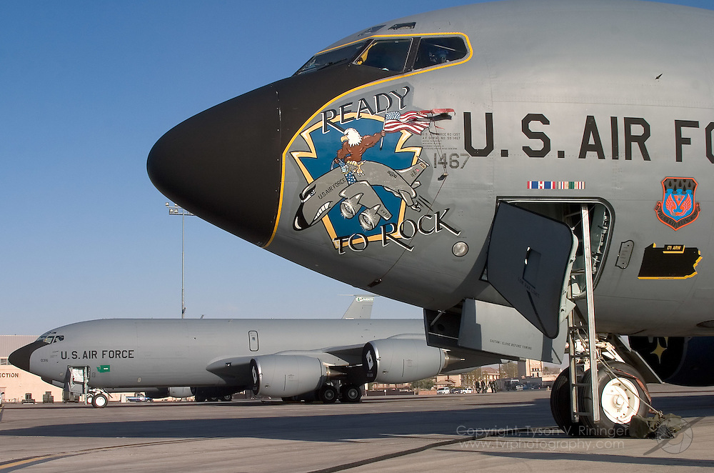 A Pittsburgh KC-135 from the 171st Aerial Refueling Wing shows off its nose art with a tanker from the 141st ARW based at Fairchild, Washington quietly sitting on the ramp. For each Red Flag sortie, a tanker is assigned to either Red Air or Blue Air to replenish fighters out on the Nellis Range. Typically, two tankers are provided for Blue Air due to the size of the force and one tanker for Red Air.