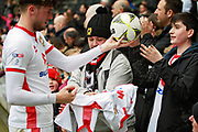 MK Dons Robbie Muirhead(16) signs shirts and give out footballs to the fans after the EFL Sky Bet League 1 match between Milton Keynes Dons and Scunthorpe United at stadium:mk, Milton Keynes, England on 28 April 2018. Picture by Nigel Cole.