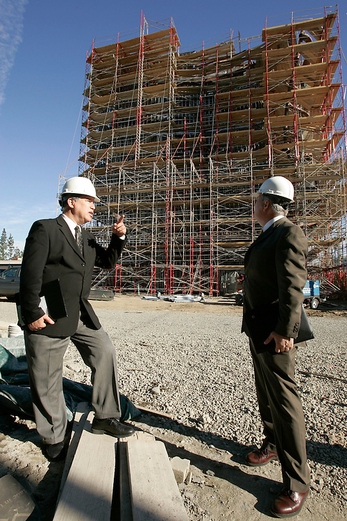 Larry Eisenberg, Executive Director, Facilities, Planning and Development for LACCD at LA Trade Tech Campus where new construction is underway. With him is Thomas Hall, Director, Facilities Planning and Development (Larry is in lighter jacket and on right when two are speaking).