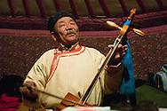 Mongolia. traditional musician in the yurt (ger)  hakhorin /  musicien traditionnel dans la yourte (ger);, (hakhorin)   karakorum - Mongolie