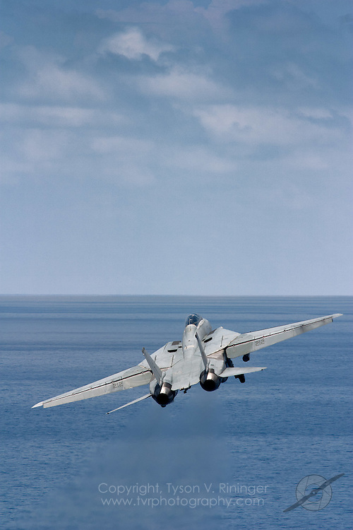 AJ212, an F-14 Tomcat from VF-213 'Blacklions', launches off the deck of the USS Theodore Roosevelt CVN-71 during sea trials prior to their 2005 Mediterranean deployment. This would be the final cruise for the F-14 Tomcat and the last time it would ever see combat.
