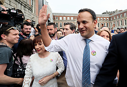 An Taoiseach Leo Varadkar waves as he arrives at Dublin Castle for the results of the referendum on the 8th Amendment of the Irish Constitution which prohibits abortions unless a mother's life is in danger. Picture date: Saturday May 26, 2018. See PA story IRISH Abortion. Photo credit should read: Brian Lawless/PA Wire