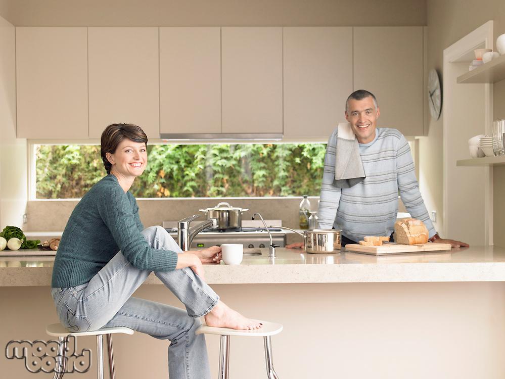 Smiling couple in kitchen (portrait)