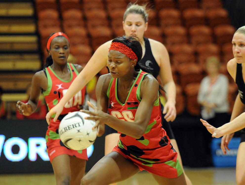 Malawis' Mwai Kumwenda against New Zealand in the International Netball test at Pettigrew Green Arena, Napier, New Zealand, Sunday, October 27, 2013. Credit:SNPA / Ross Setford
