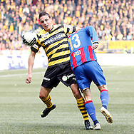 BSC Young Boys player David Degen (L) fouls FC Basel forward Alex Frei during the Super League (National League A) soccer match between BSC Young Boys (YB) and FC Basel (FCB) at the Stade de Suisse stadium in Bern, Switzerland, Sunday, Mai 16, 2010. FC Basel have won the Swiss football championship beating Young Boys of Bern 2-0 in the last match of the season. (Photo by Patrick B. Kraemer / MAGICPBK)