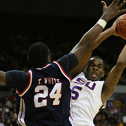 14 February 2009 LSU guard Marcus Thornton (5) shoots over Terrico White (24) of Ole Miss during a NCAA basketball game between SEC rivals the Ole Miss Rebels and the LSU Tigers at the Pete Maravich Assembly Center in Baton Rouge, LA.