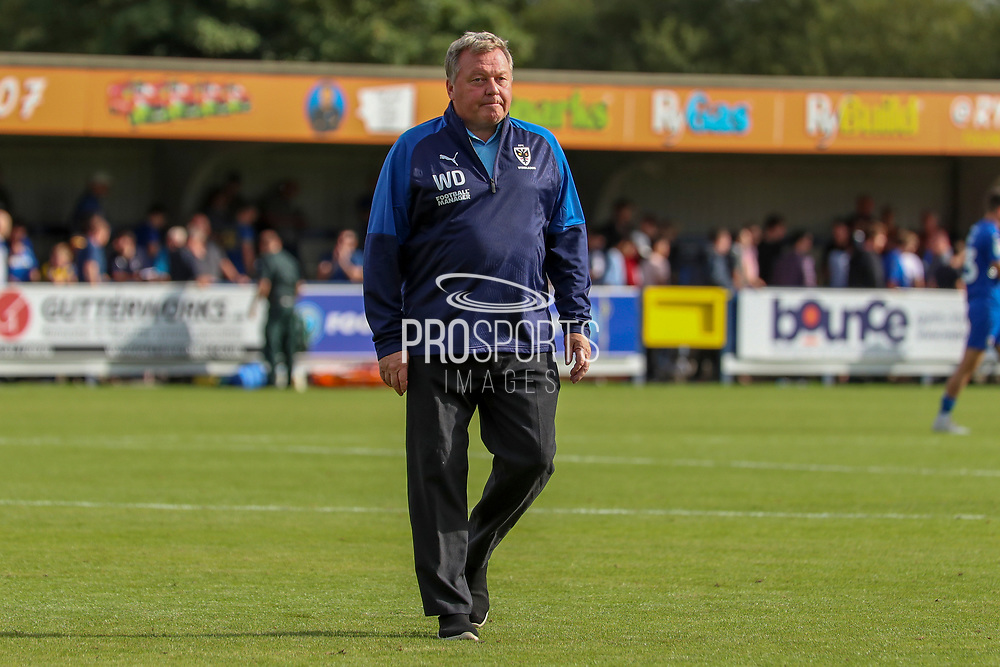 AFC Wimbledon manager Wally Downes walking off the pitch during the EFL Sky Bet League 1 match between AFC Wimbledon and Accrington Stanley at the Cherry Red Records Stadium, Kingston, England on 17 August 2019.