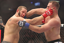 Feb 12, 2011; East Rutherford, NJ; USA; Chad Griggs (Gray trunks) and Gian Villante (White trunks) fight during their bout at Strikeforce at the IZOD Center in East Rutherford, NJ.