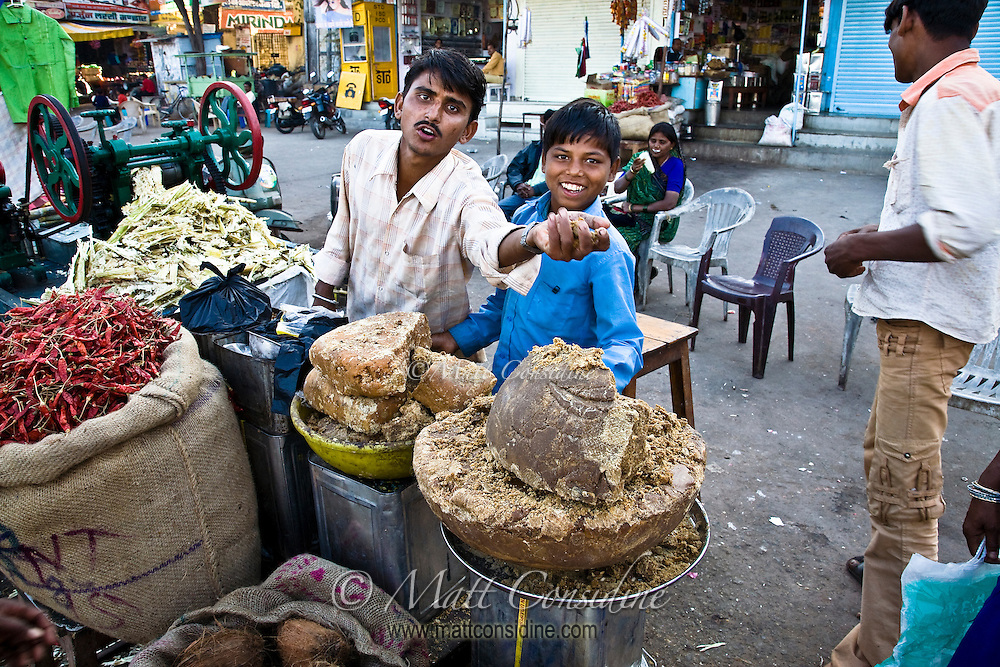 Cheerful sugar vendors in a village in Rajasthan.<br /> (Photo by Matt Considine - Images of Asia Collection)