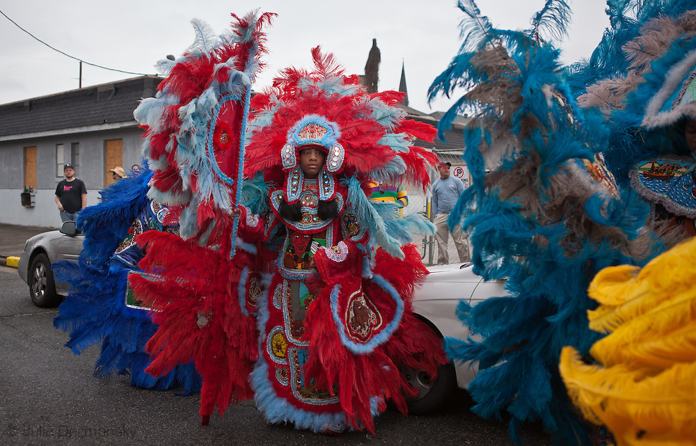 Mardi Gras Indian taking part in a second line parade, a tradition started by Aftican Americans  who weren't aloud to take  part in the parades. Mardi Gras 2011 in New Orleans is expected to be have the largest attendance of all time due to the dates overlapping with college spring break. Mardi Gras also known as Carnival begins on or after Epiphany and ending on the day before Ash Wednesday.