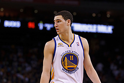 Mar 16, 2012; Oakland, CA, USA; Golden State Warriors guard Klay Thompson (11) during a stoppage in play against the Milwaukee Bucks during the fourth quarter at Oracle Arena. Milwaukee defeated Golden State 120-98. Mandatory Credit: Jason O. Watson-US PRESSWIRE