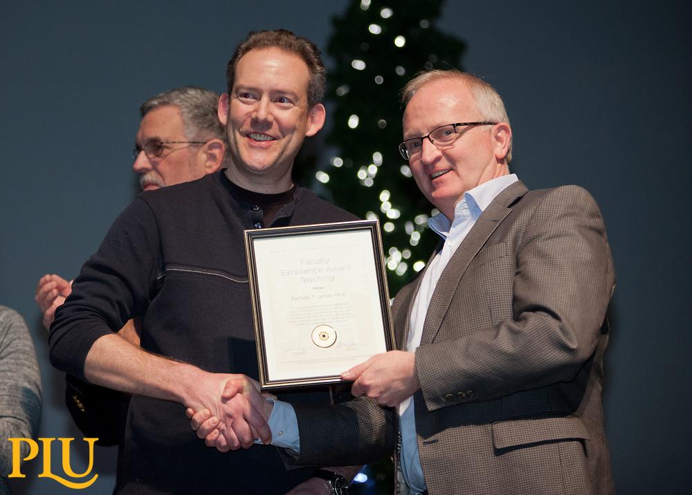 Allan Belton present an award to Zachary Lyman at the PLU Christmas Brunch, Thursday, Dec. 14, 2017. (Photo: John Froschauer/PLU)