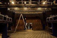 "Neil Pankhurst checking out some lighting as the stage begins preparations for the upcoming production ""Rocky Horror Show"" to start the Summer Professional Theater events at Winnipesaukee Playhouse.  (Karen Bobotas/for the Laconia Daily Sun)"