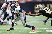 NEW ORLEANS, LA - NOVEMBER 13:  Emmanuel Sanders #10 of the Denver Broncos is grabbed from behind by Delvin Breaux #40 of the New Orleans Saints at Mercedes-Benz Superdome on November 13, 2016 in New Orleans, Louisiana.  The Broncos defeated the Saints 25-23.  (Photo by Wesley Hitt/Getty Images) *** Local Caption *** Emmanuel Sanders; Delvin Breaux