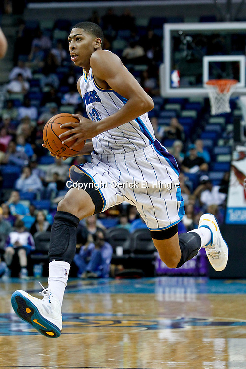 October 9, 2012; New Orleans, LA, USA; New Orleans Hornets forward Anthony Davis (23) against the Charlotte Bobcats during the first quarter of a preseason game at the New Orleans Arena. The Hornets defeated the Bobcats 97-82. Mandatory Credit: Derick E. Hingle-US PRESSWIRE