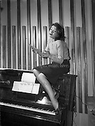 """8/12/1960<br /> 12/08/1960<br /> 08 December 1960<br /> Rehearsal for new musical """"The Crooked House"""" at Busaras Theatre, an Eamonn O Higgins production,<br /> Director J Hole. Image shows Actress Angela Nolan, playing a witch. pictures to illustrate feature by Mr. Pendlebury, Daily Mail."""