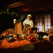 A servant pours water at the head table of a Madrigal dinner at Simpson college in Indianola, Iowa.  The medieval event is part of the traditional Christmas events held at the college.  It was part of a Renaissance Christmas