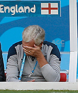 FA Director of Football Development Sir Trevor Brooking holds his head during the England training session the day before their final Group D match against Costa Rica at Mineirão, Belo Horizonte, Brazil. <br /> Picture by Andrew Tobin/Focus Images Ltd +44 7710 761829<br /> 23/06/2014