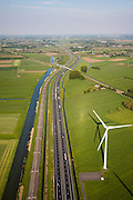 Nederland, Gelderland, Echteld, 27-05-2013;<br /> infrabundel: Rivier de Linge, Betuweroute en A15, windmolen. Spoorlijn Tiel-Elst (Betuwelijn)<br /> Motorway A15 together with freight railroad.<br /> luchtfoto (toeslag op standard tarieven)<br /> aerial photo (additional fee required)<br /> copyright foto/photo Siebe Swart