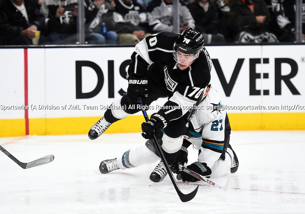 27 December 2014: San Jose Sharks Defenseman Scott Hannan (27) [1106] trips Los Angeles Kings Left Wing Tanner Pearson (70) [9482] as he attempts a shot on goal during an NHL game between the San Jose Sharks and the Los Angeles Kings at STAPLES Center in Los Angeles, CA.