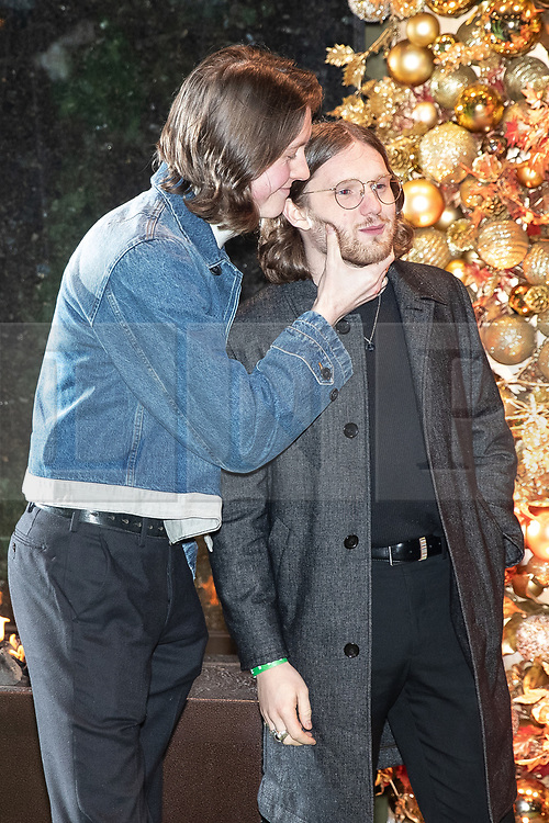 © Licensed to London News Pictures . 23/11/2018. Manchester , UK . Musicians Tom Ogden and Joe Donovan from Blossoms arrive at an opening event of The Ivy restaurant and bar venue in Spinningfields in Manchester City Centre . Photo credit : Joel Goodman/LNP
