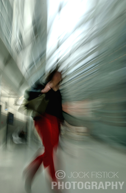 PARIS, FRANCE - APRIL-21-2004 - technology - high tech - high-tech - hi tech - hi-tech - communication - light speed - moving - move - swish - hurry - hurried - rush - rushed - late - frenzied - business - motion - movement - fast - pace - paced - quick - blur - blurry - walk - run - red pants - black shirt - cool - dream - dreamy(PHOTO © JOCK FISTICK)